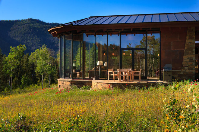 Rustic Exterior by Teton Heritage Builders
