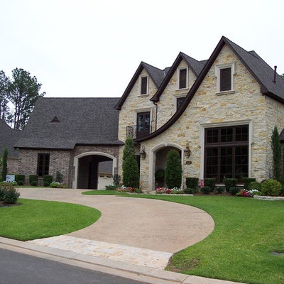 Large elegant beige two-story mixed siding exterior home photo in New Orleans with a hip roof