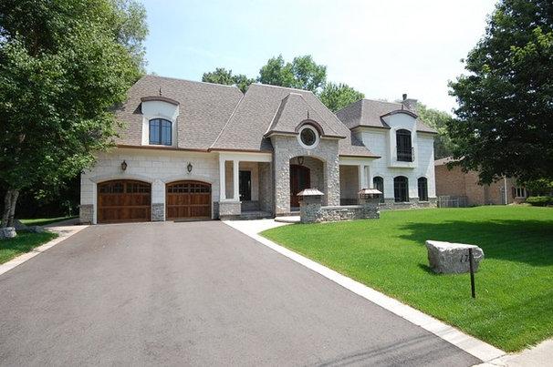 Traditional Exterior by KEYSTONE Home Designs by Gerardo Castillo