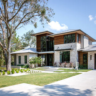 Large trendy two-story wood house exterior photo in Jacksonville with a metal roof