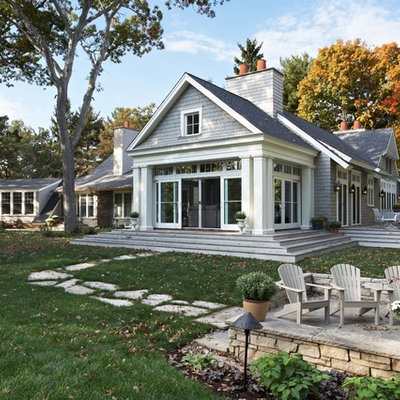 Inspiration for a timeless stone gable roof remodel in Minneapolis