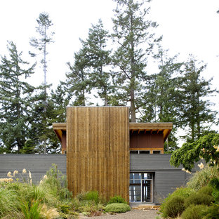 Inspiration for a mid-sized contemporary gray two-story wood exterior home remodel in Seattle