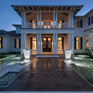 Huge asian white two-story stucco exterior home idea in Miami