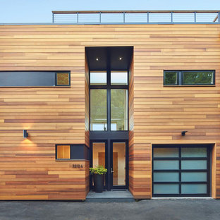 Example of a danish beige two-story wood exterior home design in Seattle