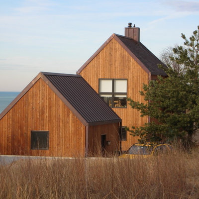 Elegant brown two-story wood gable roof photo in Chicago
