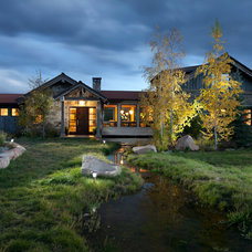 Rustic Exterior by Snake River Interiors