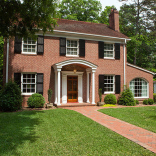 Mid-sized elegant red two-story brick house exterior photo in Charlotte