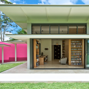 Large contemporary pink one-story exterior home idea in Sydney with a shed roof