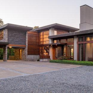 Exempel på ett modernt hus, med två våningar, blandad fasad och platt tak
