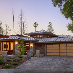 Large mountain style brown two-story mixed siding house exterior photo in San Francisco with a hip roof and a metal roof