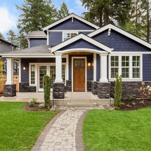 Inspiration for a timeless blue two-story wood exterior home remodel in Other with a shingle roof
