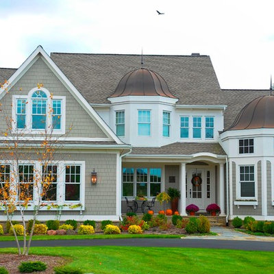 Large elegant beige two-story wood exterior home photo in Detroit with a mixed material roof