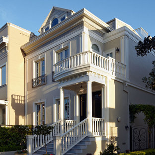 Large victorian exterior in San Francisco with three or more floors.