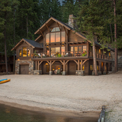 Inspiration for a mid-sized rustic brown two-story wood exterior home remodel in Seattle with a shingle roof