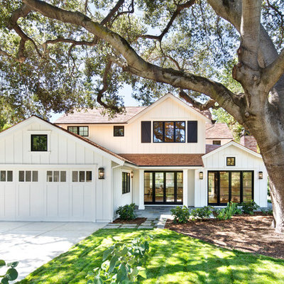 Country white two-story wood gable roof idea in San Francisco