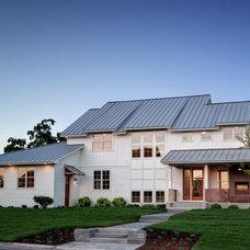 Farmhouse Exterior by AMEK Custom Builders