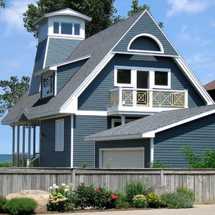 Traditional blue two-story exterior home idea in New York