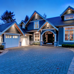 Medium sized traditional two floor exterior in Vancouver with wood cladding and a pitched roof.
