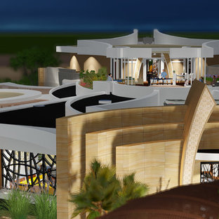 Example of a huge minimalist two-story stucco apartment exterior design in Phoenix