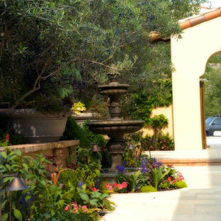 Inspiration for a large mediterranean brown one-story brick exterior home remodel in Orange County