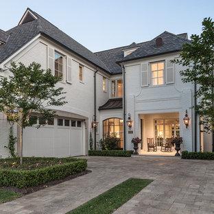 Elegant white brick exterior home photo in Houston