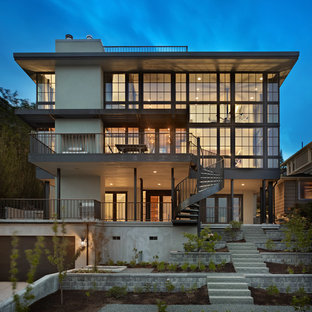 Example of a trendy concrete exterior home design in Seattle
