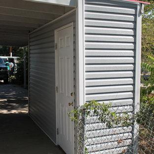 Small midcentury modern gray one-story vinyl duplex exterior idea in Denver