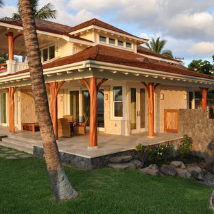 Mid-sized island style two-story stone exterior home photo in Hawaii