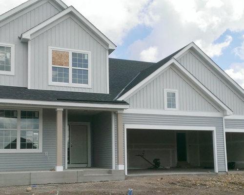 trendy gray twostory vinyl exterior home photo in minneapolis