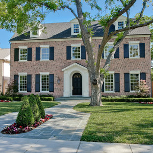 Large traditional brown two-story brick exterior home idea in Dallas with a shingle roof
