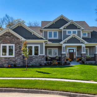 Inspiration for a craftsman gray two-story concrete gable roof remodel in Other