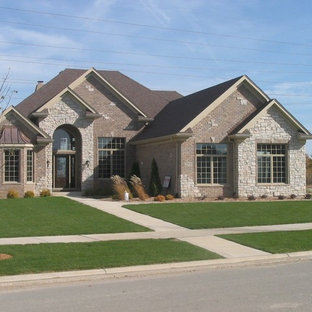 Example Of A Mid Sized Clic Gray Two Story Stone Exterior Home Design In