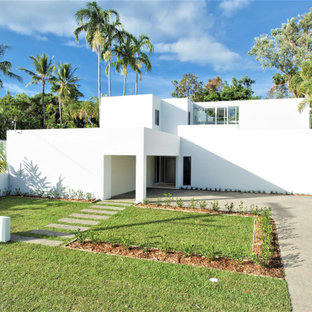 Design ideas for a modern two-storey white house exterior in Cairns with a flat roof.