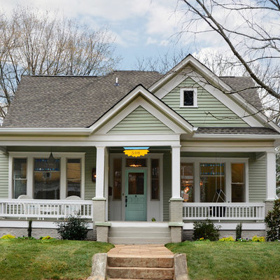 Inspiration for a mid-sized timeless two-story wood exterior home remodel in Atlanta with a shingle roof