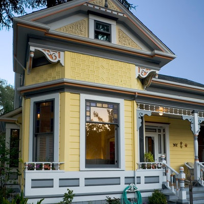 Example of an ornate yellow exterior home design in San Francisco
