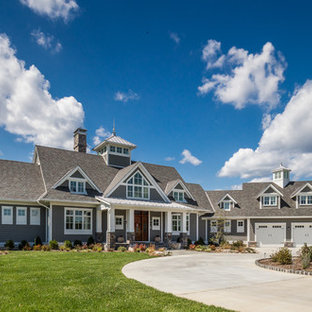 Beach style gray two-story gable roof idea in Baltimore