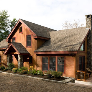 Rustic exterior in Boston with wood cladding.