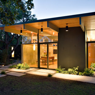 Inspiration for a mid-sized midcentury one-storey brown exterior in San Francisco with wood siding and a flat roof.