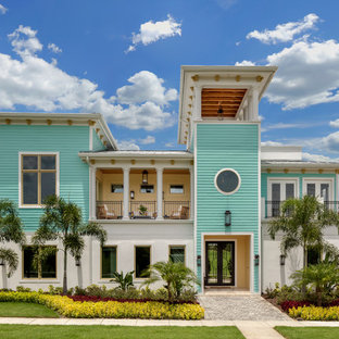 Beach style multicolored two-story mixed siding house exterior idea in Orlando with a hip roof