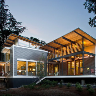 Inspiration for a mid-sized contemporary gray two-story wood exterior home remodel in Atlanta