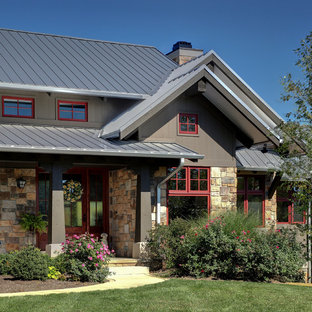 Example of a farmhouse stone exterior home design in Chicago