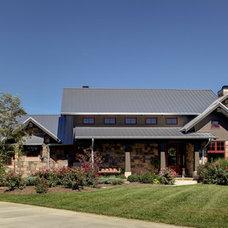 Farmhouse Exterior by HELMAN SECHRIST Architecture