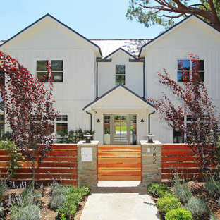 Inspiration for a traditional two-storey white exterior in Los Angeles with wood siding.