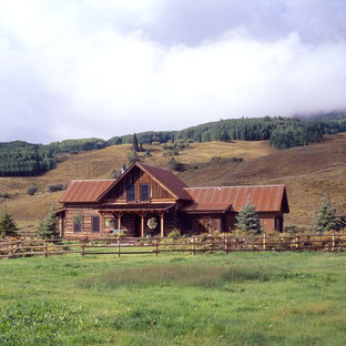 This is an example of a mid-sized country two-storey exterior in Denver with wood siding.
