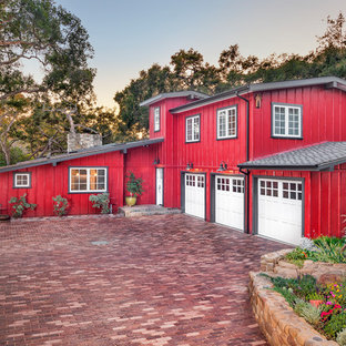 Cottage red two-story exterior home idea in Santa Barbara with a shingle roof