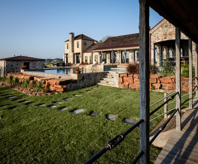 Rustic Exterior by Thompson Custom Homes