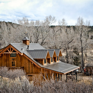 Mid-sized southwestern brown two-story wood gable roof idea in Albuquerque