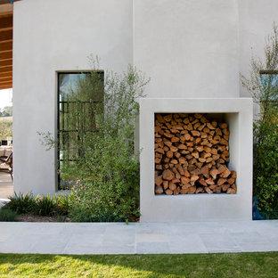 Mediterranean white exterior home idea in San Diego