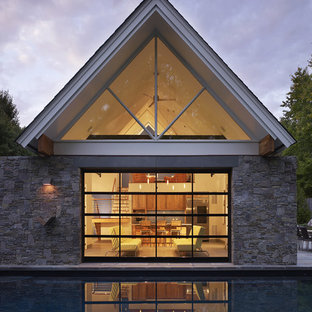 Small contemporary one-story stone gable roof idea in DC Metro