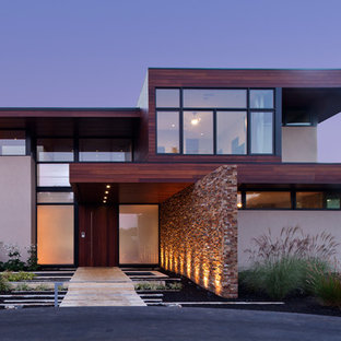 Inspiration for a large contemporary beige two-story mixed siding flat roof remodel in San Francisco